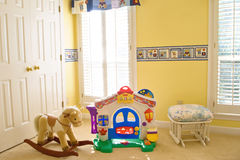 Cozy baby room with toys royalty free stock photos