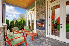Cozy backyard with fireplace in luxury house Royalty Free Stock Image