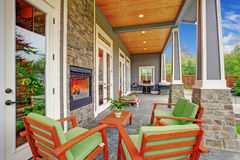 Cozy backyard with fireplace in luxury house Stock Photography