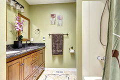 Cozy bathroom interior in ivory tones with orchid pot Stock Photo