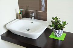 Cozy bathroom. With modern bathroom sink royalty free stock photo