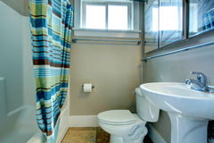 Cozy bathroom with striped curtains Stock Photography