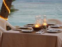 Cozy beach restaurant. Table setting stock photography
