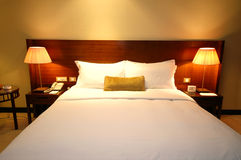 Cozy Bed. Spacious and nicely deocrated room. Brown Theme with King Bed stock image