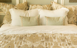 Cozy bedding on bed. Cozy welcoming comfortable bedding on bed in bedroom royalty free stock images