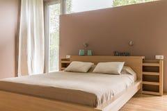 Cozy bedroom in beige idea Stock Image