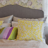 Cozy bedroom interior with colorful pillow on bed Royalty Free Stock Photos