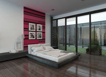 Cozy bedroom interior with pink/red colored wall Royalty Free Stock Images