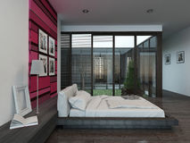 Cozy bedroom interior with pink/red colored wall Royalty Free Stock Photography
