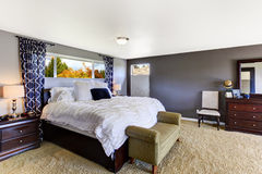 Simple Bedroom With Decorative Bedding And Purple Interior Carpet