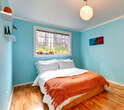 Cozy bedroom in light blue color Royalty Free Stock Photo