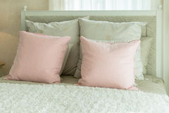 Cozy bedroom with pink pillows on beds Stock Photos