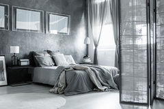 Cozy bedroom with simple accessories. White and gray cozy bedroom with simple accessories and poster Stock Photography