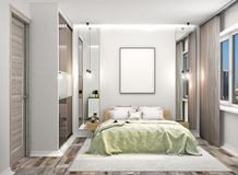 Free Cozy Bedroom With A Wardrobe With Mirrored Doors Next To The Bed. Blank Canvas Hung On The Wall Above The Bed. Royalty Free Stock Photo - 131654485