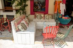 Cozy bench and sets in one taverna in the street in Lefkada-2. Cozy table and seats in one taverna in the streets of Lefkada Town in Greece stock photos