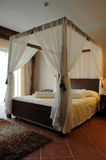Cozy boudoir. Ambience and romantic athmosphere of a bedroom with curtains Royalty Free Stock Images