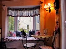 Cozy breakfast nook in bright bay window Stock Images