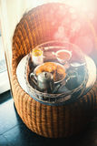 Cozy Breakfast on rustic tray on chair at morning Stock Photography