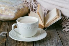 Cozy breakfast with warm plait and hot tea with milk Stock Photo