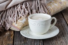 Cozy breakfast with warm plait and hot tea with milk Royalty Free Stock Photos