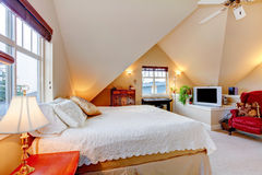 Cozy bright bedroom with cream color vaulted ceiling Stock Photos