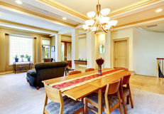 Cozy bright dining room connected with living room. View of entr Stock Photos