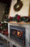 Cozy burning fireplace with christmas decorations Stock Images