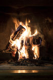 Cozy burning fireplace at home Stock Photo