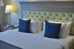 Cozy business hotel bed. A very cozy business hotel bed for two guests as it provides six pillows for comfortable stay Stock Images