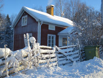 Cozy cabin in Swedish winter. An inviting guest house in winter time Royalty Free Stock Photography