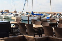 The cozy cafe in the Mediterranean port. Horizontal Stock Photo