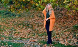 Cozy casual outfits for fall. Cozy outfit ideas for weekend. Woman walk sunset light. Clothing for every day. Girl. Adorable blonde posing in warm and cozy stock photo