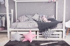 Cozy children`s bedroom in scandinavian style with diy accessories Royalty Free Stock Images