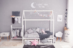 Cozy children`s bedroom in scandinavian style with diy accessories stock images