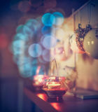Cozy Christmas decoration with candles and festive bokeh lighting Royalty Free Stock Image
