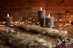 Cozy christmas decoration with candles stock photos