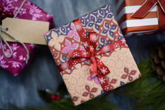 Cozy christmas gifts. High-angle shot of some cozy christmas gifts wrapped in different nice papers and tied with ribbons and strings of different colors on a stock image