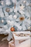 Cozy christmas holiday decoration with ornaments and christmas tree. And white lantern stock image