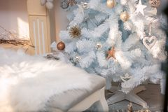 Cozy christmas holiday decoration with ornaments and christmas tree. Cozy christmas holiday decoration with ornaments. A cozy place in the time of winter royalty free stock photography