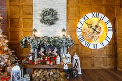 Cozy christmas interior with decorated fireplace Stock Photos