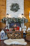 Cozy christmas interior with decorated fireplace Stock Images