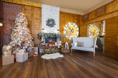 Cozy christmas interior with fir tree and fireplace Stock Images