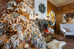 Cozy christmas interior with fir tree and fireplace Royalty Free Stock Image