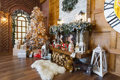 Cozy christmas interior with fir tree and fireplace Royalty Free Stock Photos