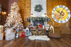 Cozy christmas interior with fir tree and fireplace Stock Image