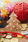 Cozy christmas ornaments. Closeup of some cozy handmade christmas ornaments such as a fabric christmas tree and some christmas balls made with notions on a stock images