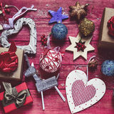 Cozy christmas ornaments and gifts. High-angle shot of some cozy rustic christmas ornaments, such as a wooden reindeer some star-shaped ornaments or some baubles Stock Image