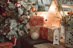 Cozy Christmas still life with a lantern in the form of a star and a New Year tree. With decorations stock photo