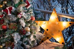 Cozy Christmas still life with a lantern in the form of a star and a New Year tree. Christmas composition stock images