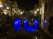 Cozy city bridge with blue neon lights under in netherlands, utrecht. Dutch city during the weekend day with people enjoying beautiful autumn day Royalty Free Stock Photos